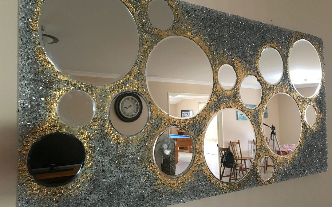 Add a touch of glamour to your home with a crushed glass and resin mirror!